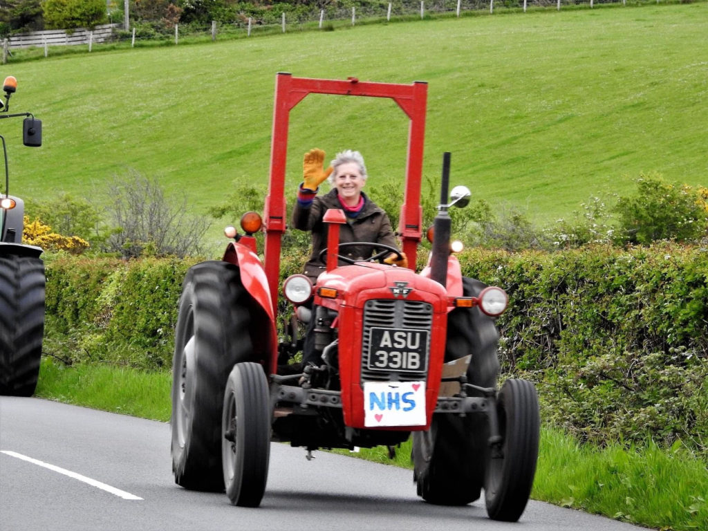 Amanda Grindall on her tractor thanking the NHS in Shiskine.