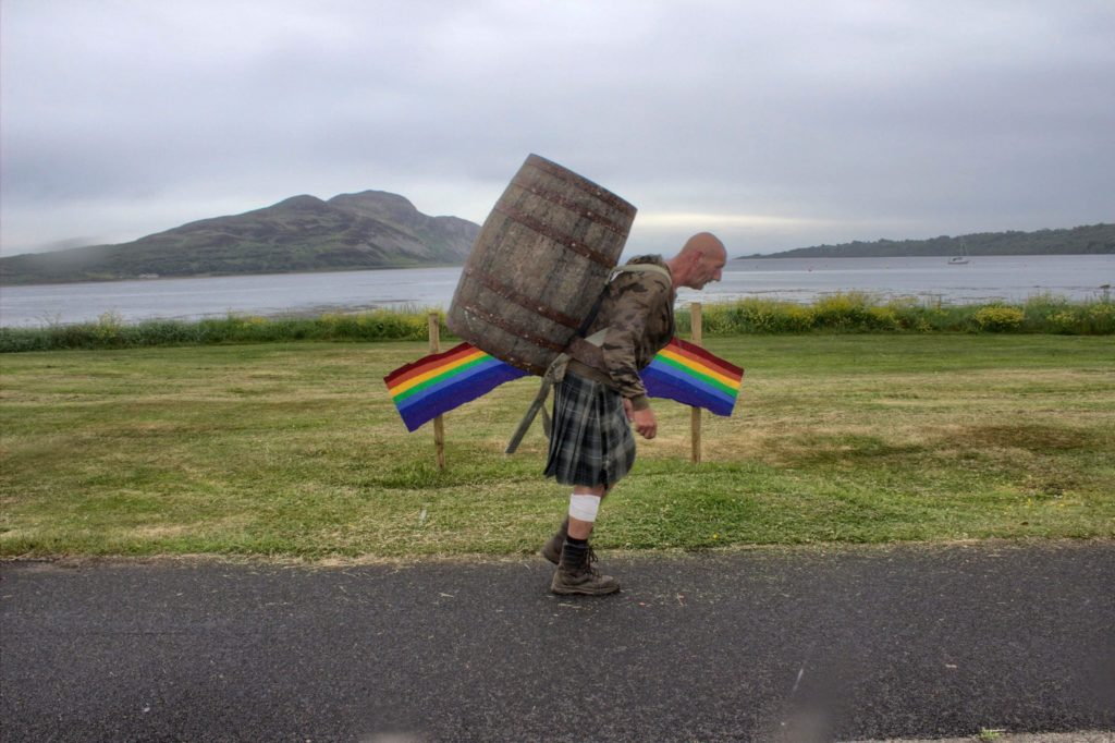 Davy passes the new rainbow landmark in Lamlash.