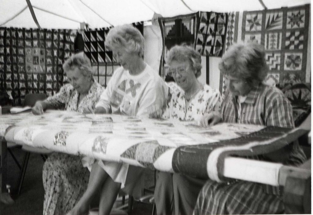 An exhibition of quilting and needlework was held at Brodick Castle last weekend. Here we see quilters Grace Dickson, Judy McAllister, Pat Nicholls and Jean Chappell at work on a quilt which will be raffled to raise money for the Save the Children Fund.