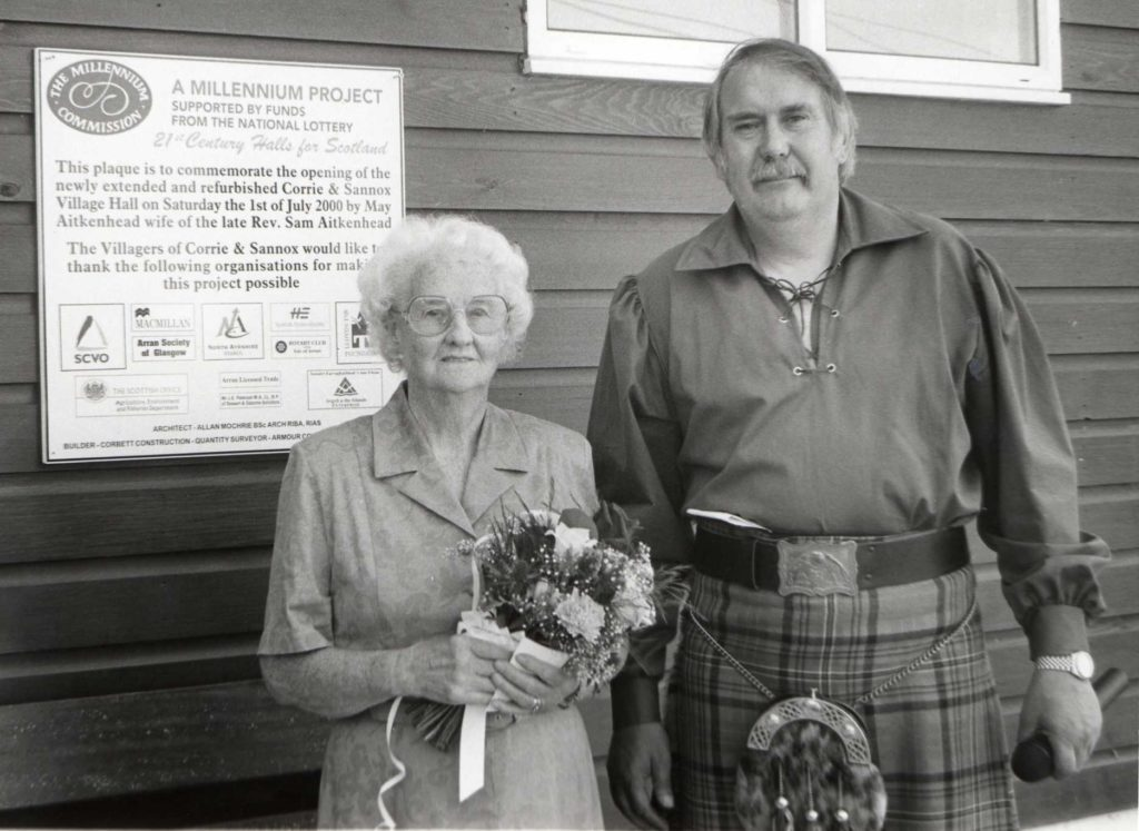 Corrie and Sannox village hall has benefited from a £150,000 upgrade under the 21st Century Halls for Scotland scheme. The official reopening was conducted by by Mrs May Aitkenhead, seen here with hall committee chairman Jim Lees. Mrs Aitkenhead is the wife of the late Rev Sam Aitkenhead who came to Corrie every year.