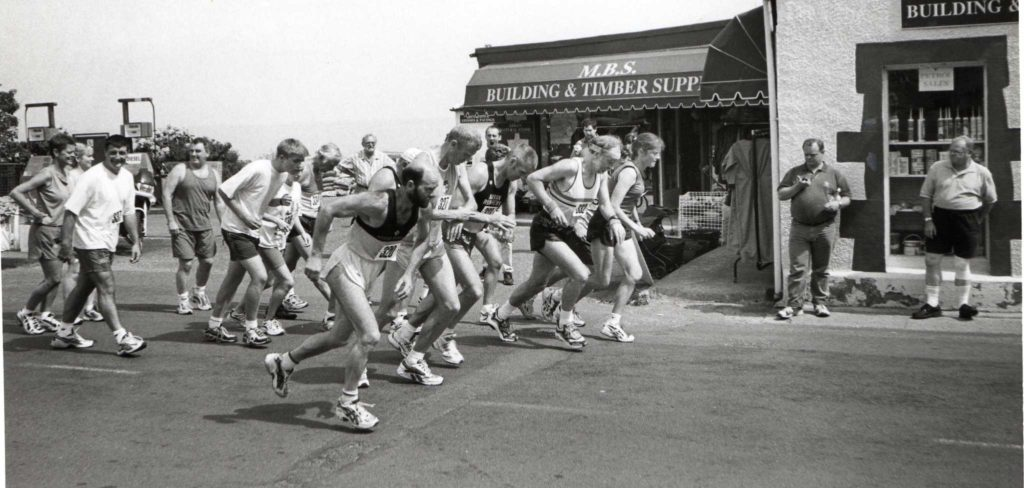 Runners set off at the start of the road race.
