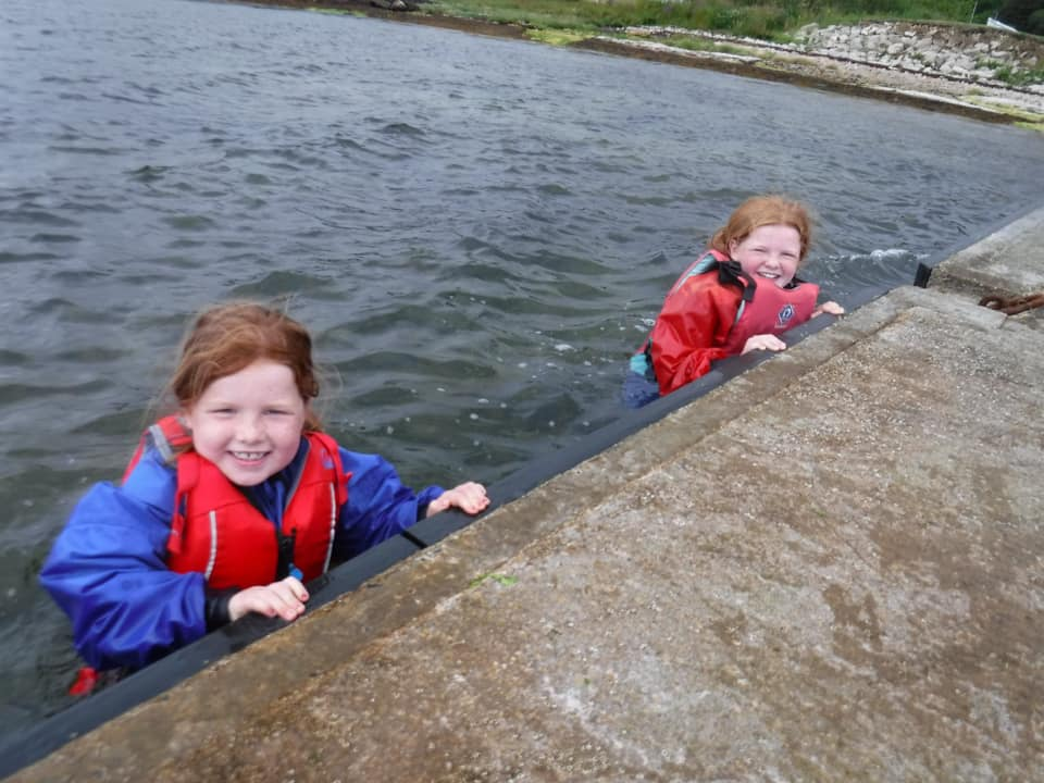 Two youngsters get aclimatised to the water