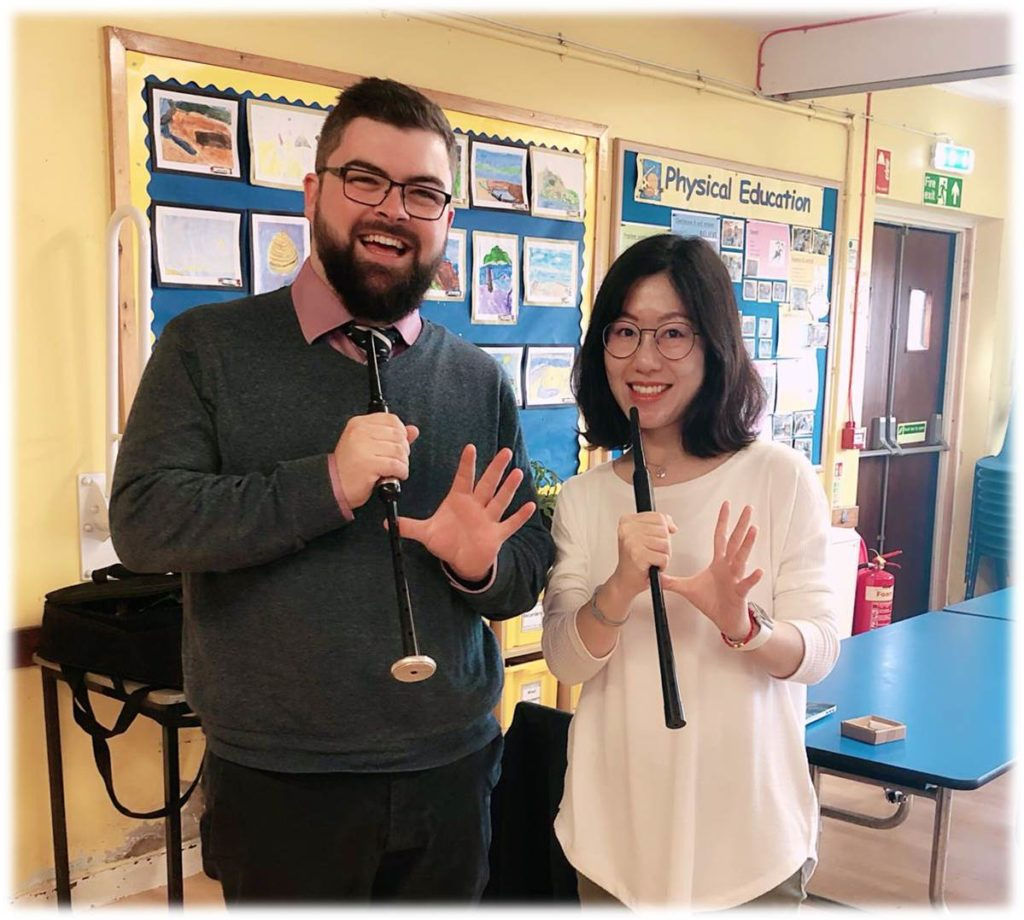 T is for Teachers. Miss Dong enjoys a chanter lesson with tutor Ross Miller.