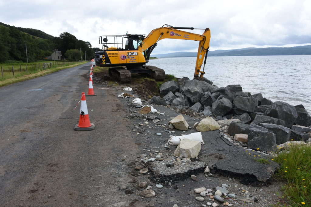 The badly eroded road south of Pirnmill with the new rock delivered seen on the shore.