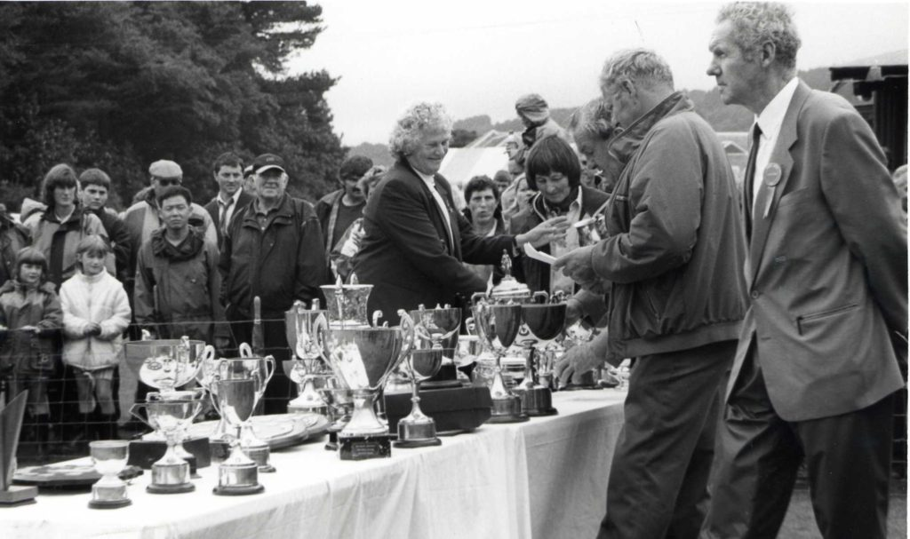 Mrs Laura Murchie presents the trophies at the end of the wet Farmers Show.
