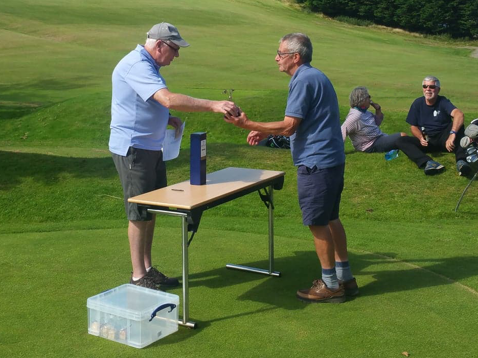 Colin Nisbet receiving his prize from Whiting Bay captain Andy Martin.