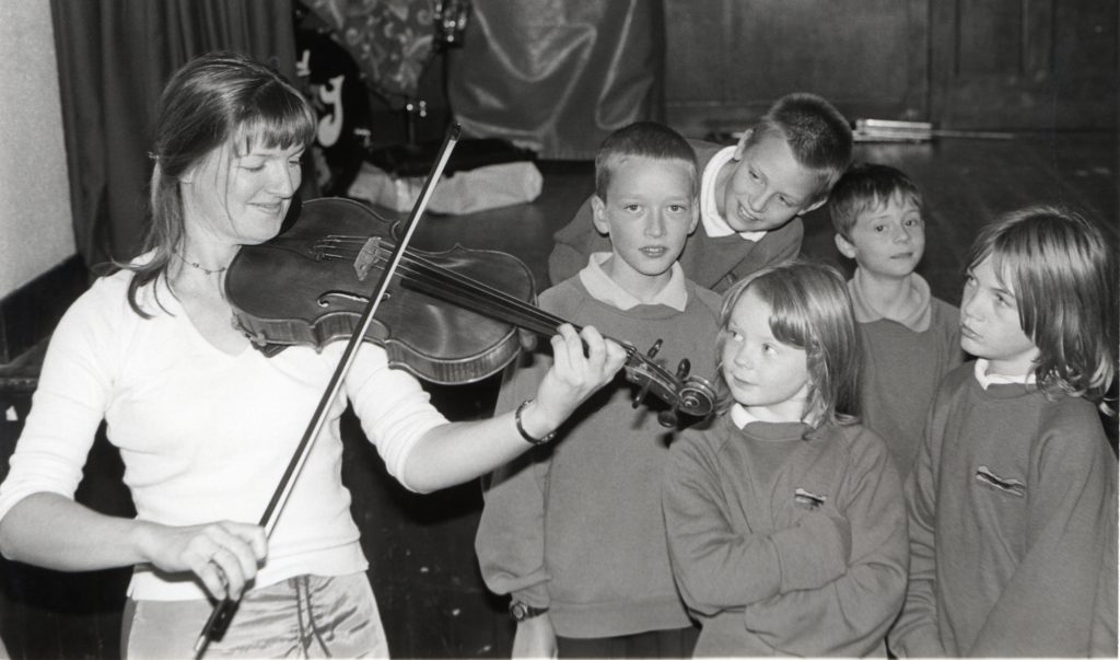 The BT Scottish Ensemble spent much of the week on the island for its sixth Arran Festival of Music. Rebecca Low is pictured playing the viola for children at Shiskine Primary School while violinist Carole Howat is with children from Pirnmill Primary School. 01_B37tweY05 and 01_B37tweY06