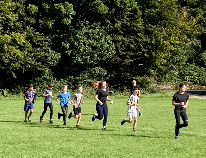 A group run round the high school playing field.