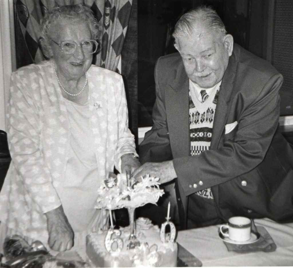 George and Winnie Munro of Pirnmill cut their diamond wedding cake.