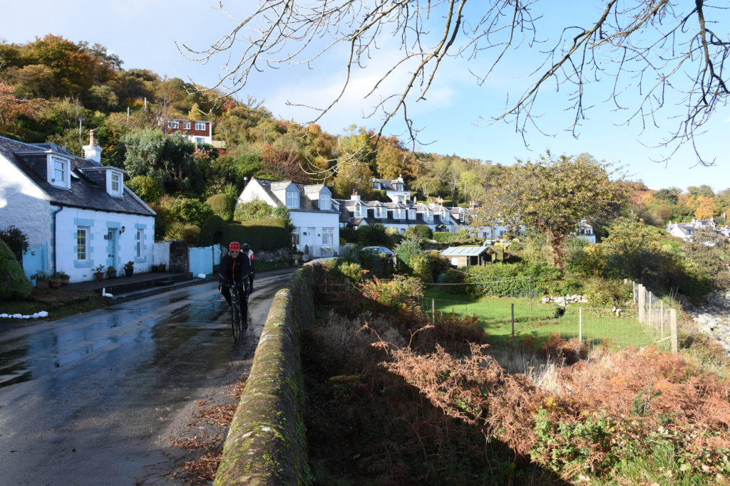 The most picturesque part of the village with the largely whitewash houses on one side of the road and the gardens on the other.