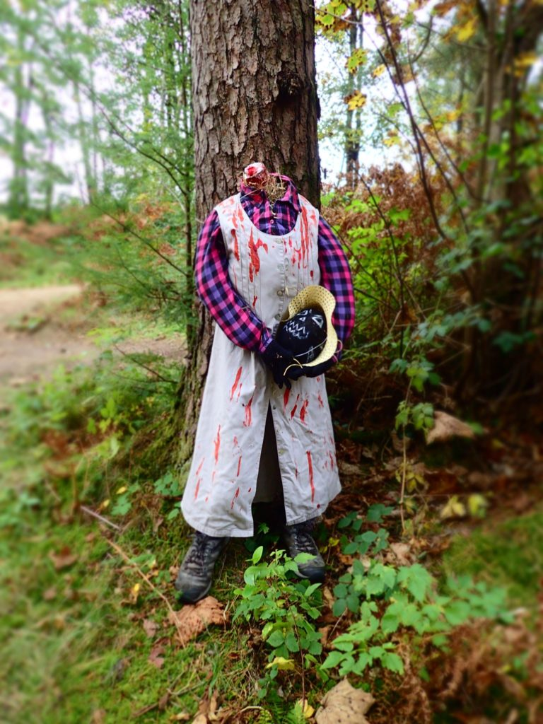 A very scary scarecrow! Watch out for this gory headless bogle in the woods.