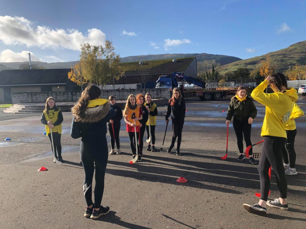Pupils prepare to take part in a hockey exercise.