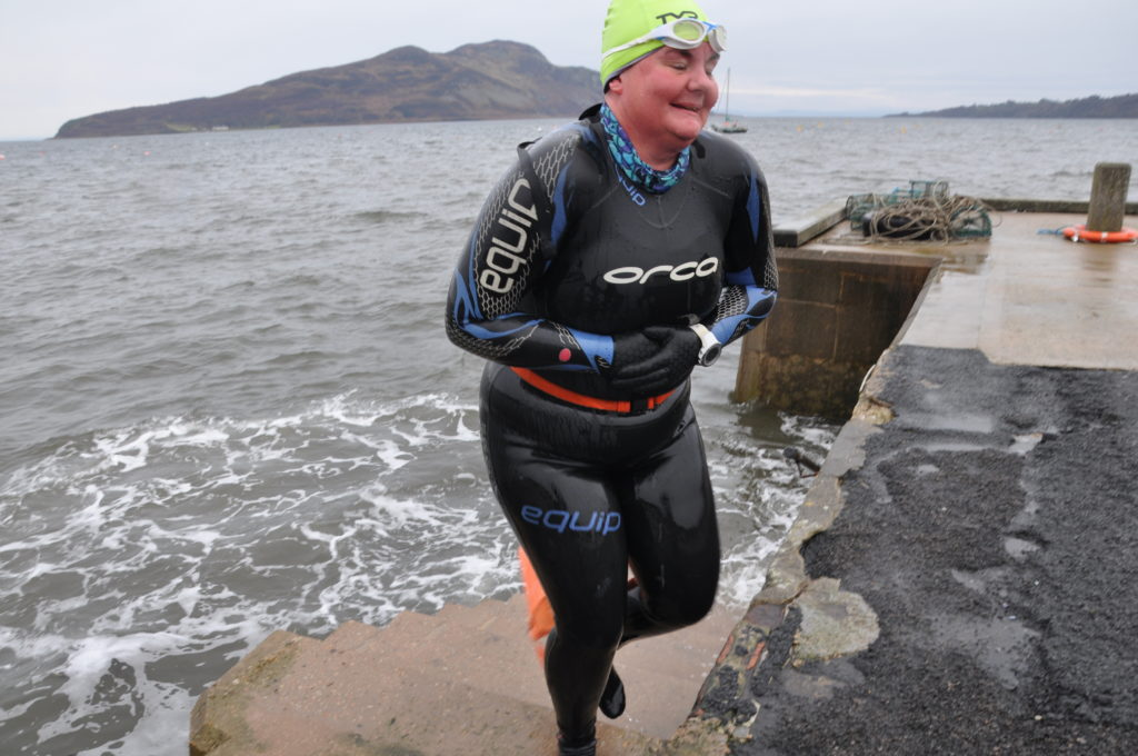 JANUARY: Georgina Lepley Maclean emerges from the water in Lamlash Bay after taking part in a traditional dook on Boxing Day.