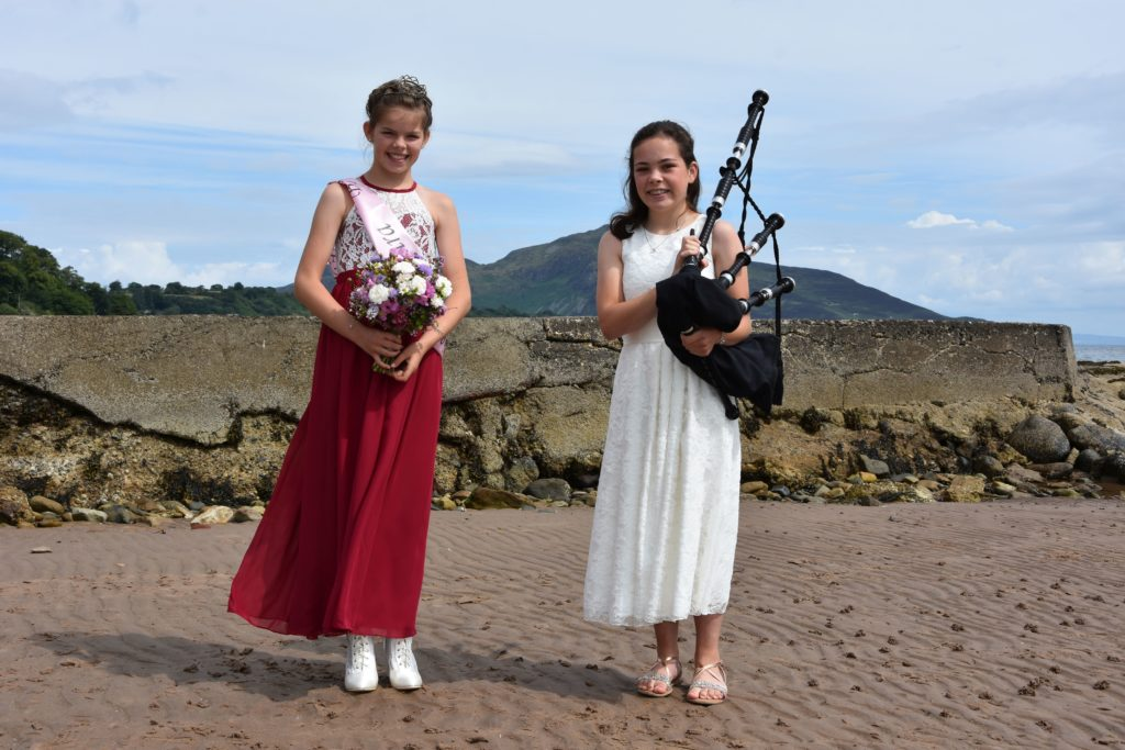 JULY: While the official Bay Queen ceremony had to be cancelled this year, Whiting Bay's Bay Queen,  Rosie McNamara, still enjoyed a small ceremony during which last year's Queen, Annie West, played the pipes.