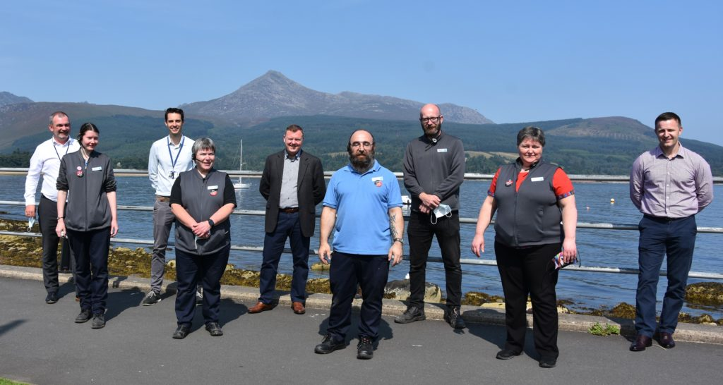 AUGUST: Co-op bosses and staff celebrate in the shadow of Goatfell after the Big Co in Brodick was named as the best team in Britain at the 2020 Succeed Together Awards.