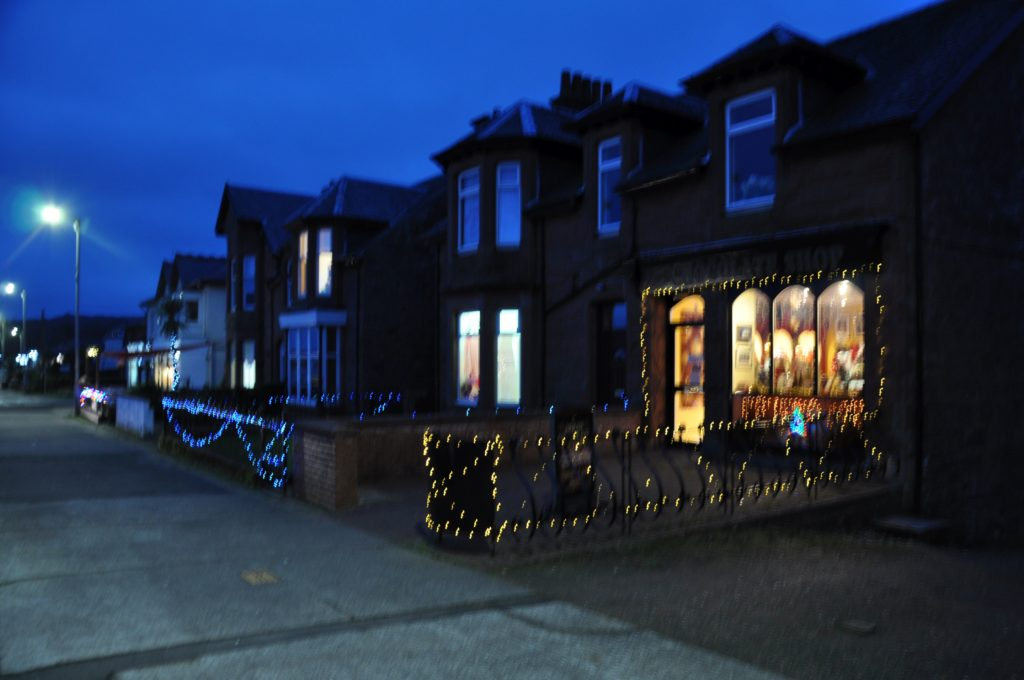 A stretch of Brodick Main Road bedecked in festive lights.