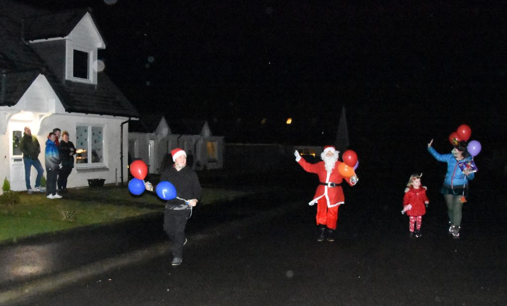 Santa and his helpers making making their rounds.