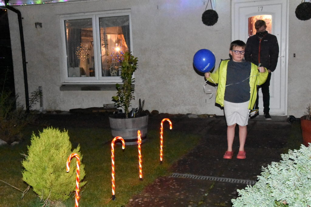 Lachlan with his gift and balloon.