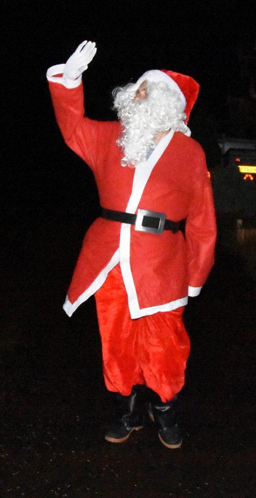 Santa waves to wellwishers.