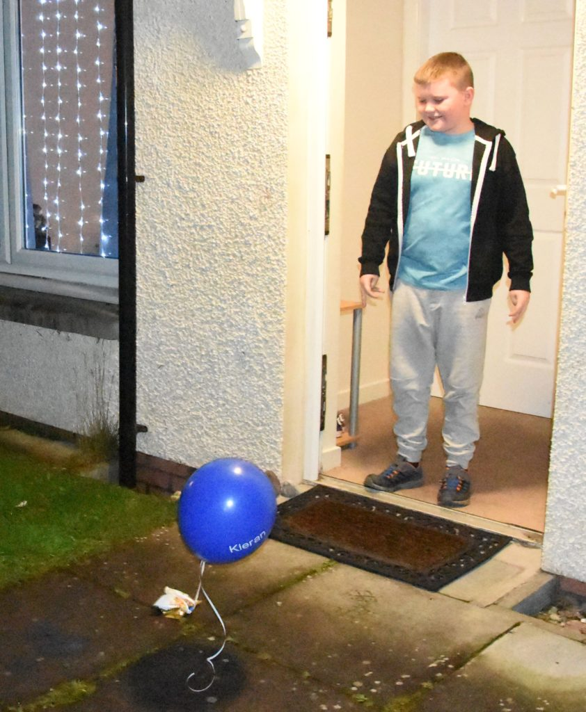Kieran is surprised to find a gift at his door.
