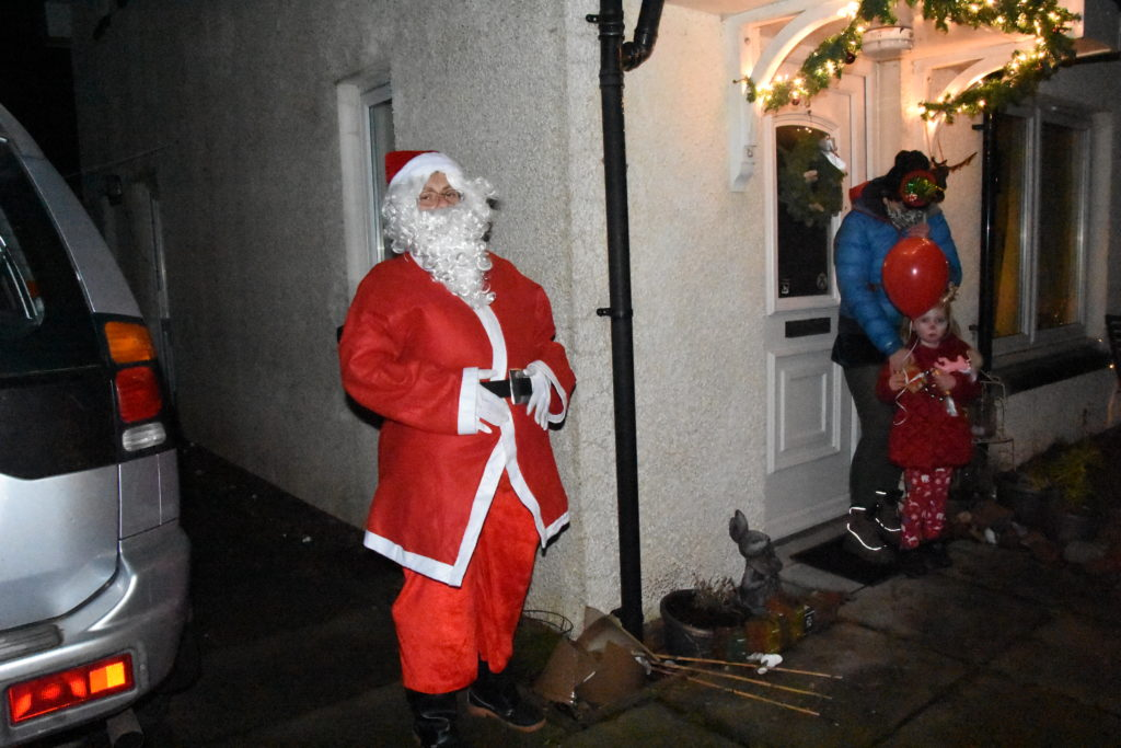 Loxa and mum Shona chat to Santa from their front door.