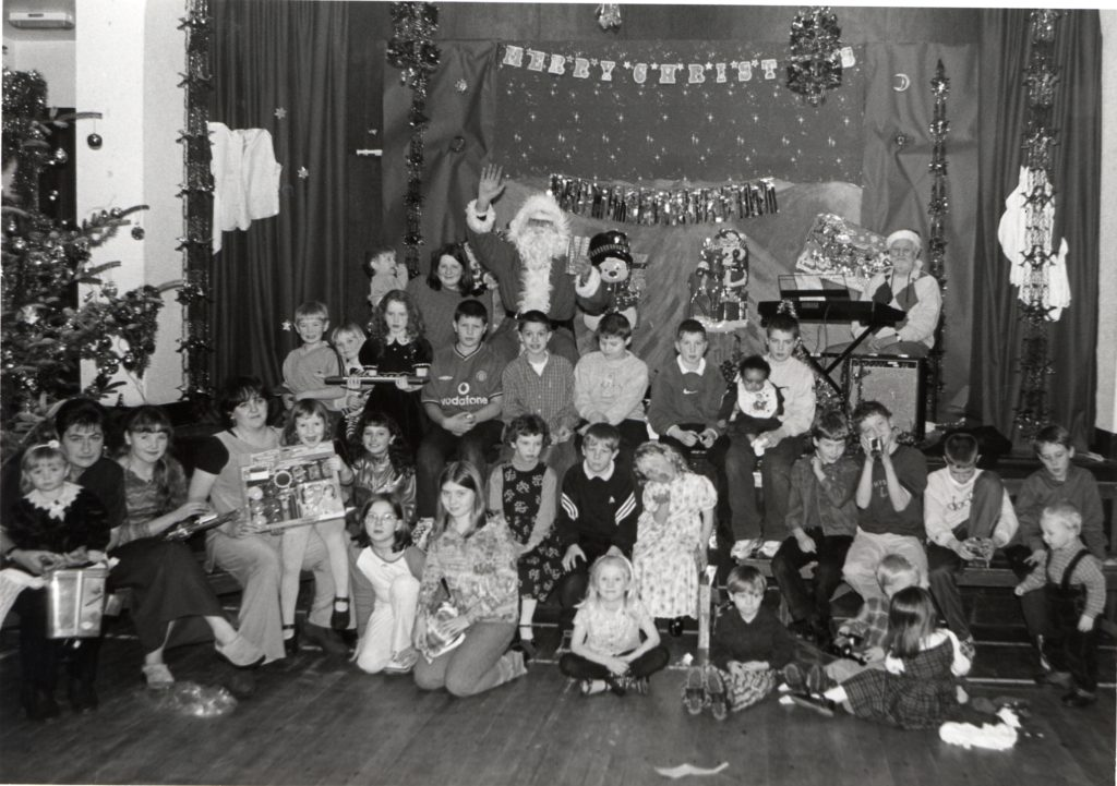 Happy children with their presents at the Kilmory Hall Christmas party.