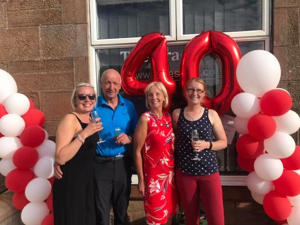 JULY: Alice Anderson, along with husband William and daughters Dawn Johnstone and Faye Anderson, celebrate the 40th anniversary of the Brae Salon in Blackwaterfoot.