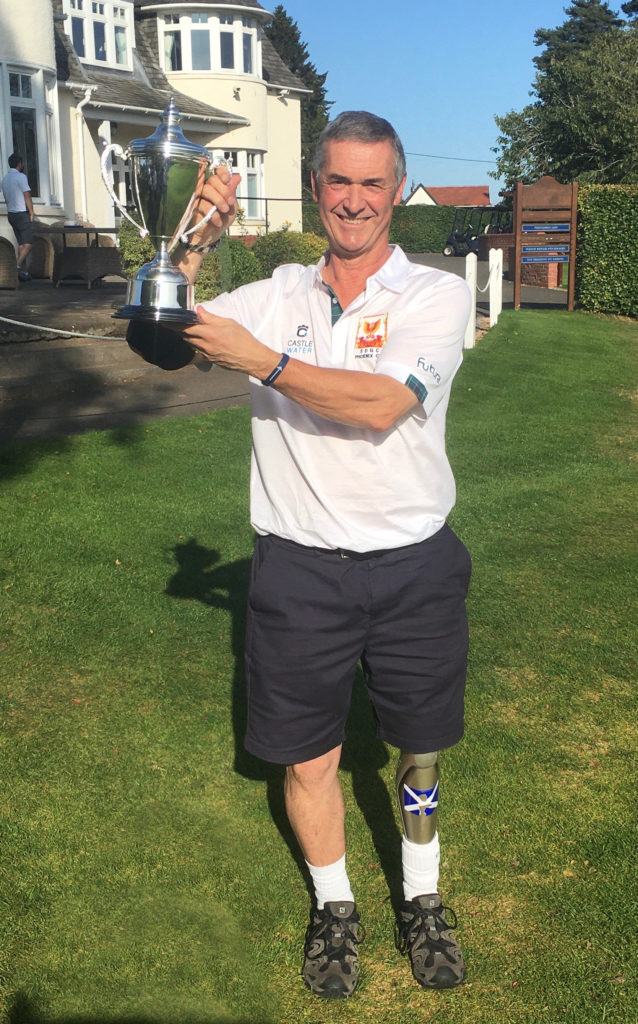 SEPTEMBER: John Pennycott of Whiting Bay with the Phoenix Cup which he won as part of the European team.