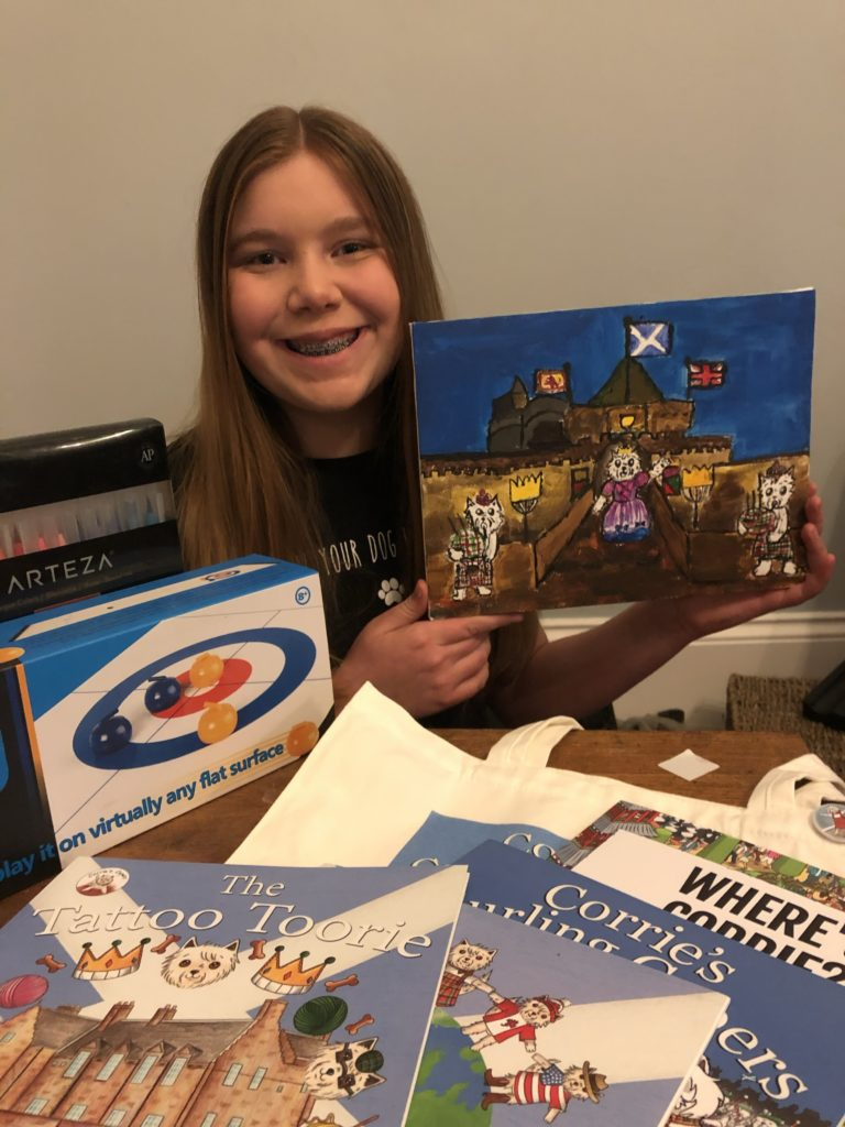 Lucia Farquhar, 11, with her winning painting of Edinburgh Castle in the age seven and over category.