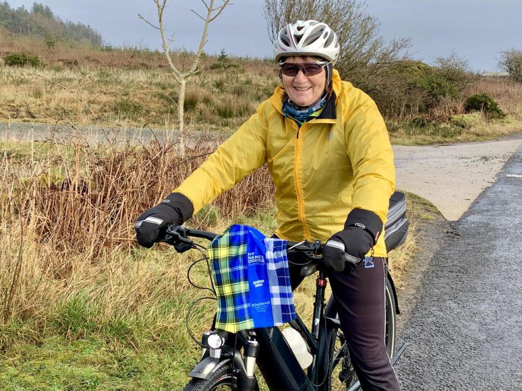 An Arran Belle takes her Doddie buff on a cycle to High Kildonan.