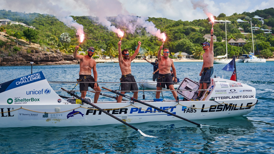 All smiles for the exhausted crew at the finish in Antigua.