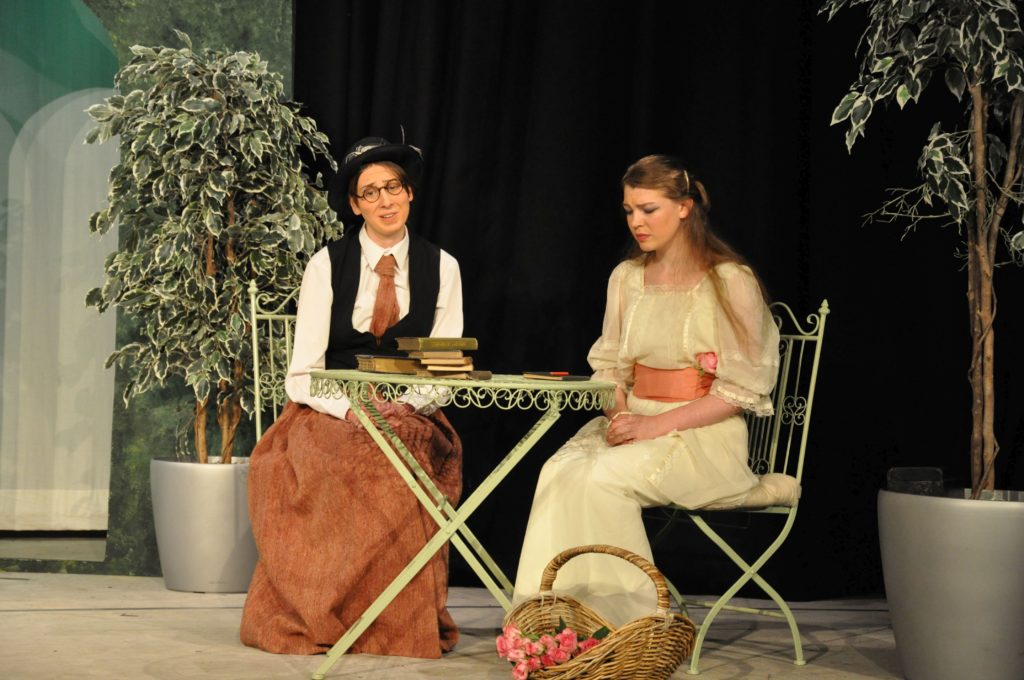 Katharine performing in her final school play in 2013, The Importance of Being Ernest, on stage with Iona Flewitt.