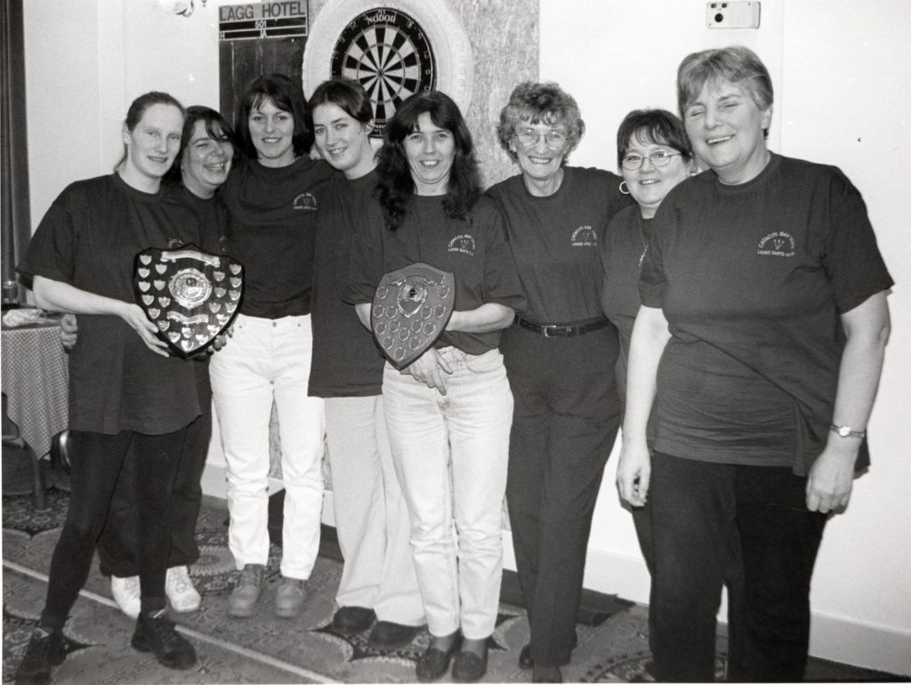 Arran Ladies Darts League winners from the Catacol Bay Hotel with their trophies at the end-of-season prizegiving.
