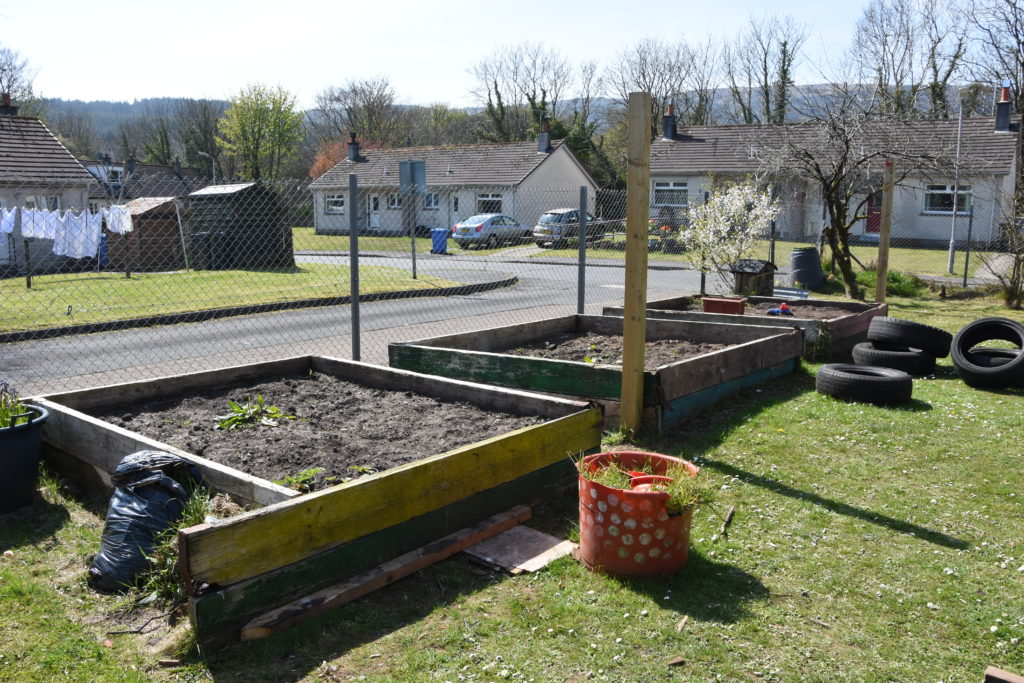 The raised beds where herbs and vegetables will be grown.