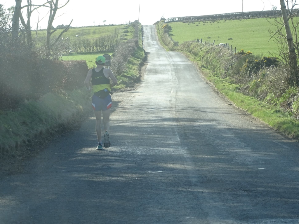 A long straight road stretches out before Dave.