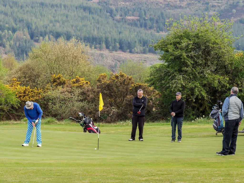 Brian Sherwood sinks one for Machrie on the 9th green during the AGA Seniors Crystal Bowl. Photograph: David Brookens.