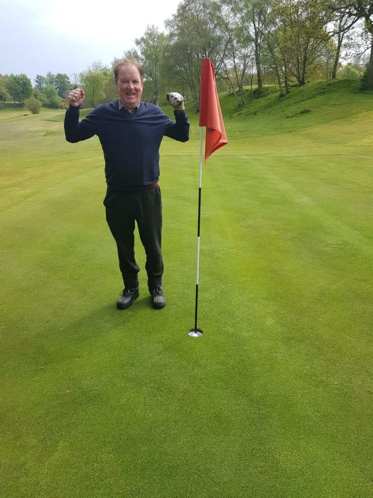 Alan Smith of Corrie celebrates a hole in one at the Corrie Saturday Medal.