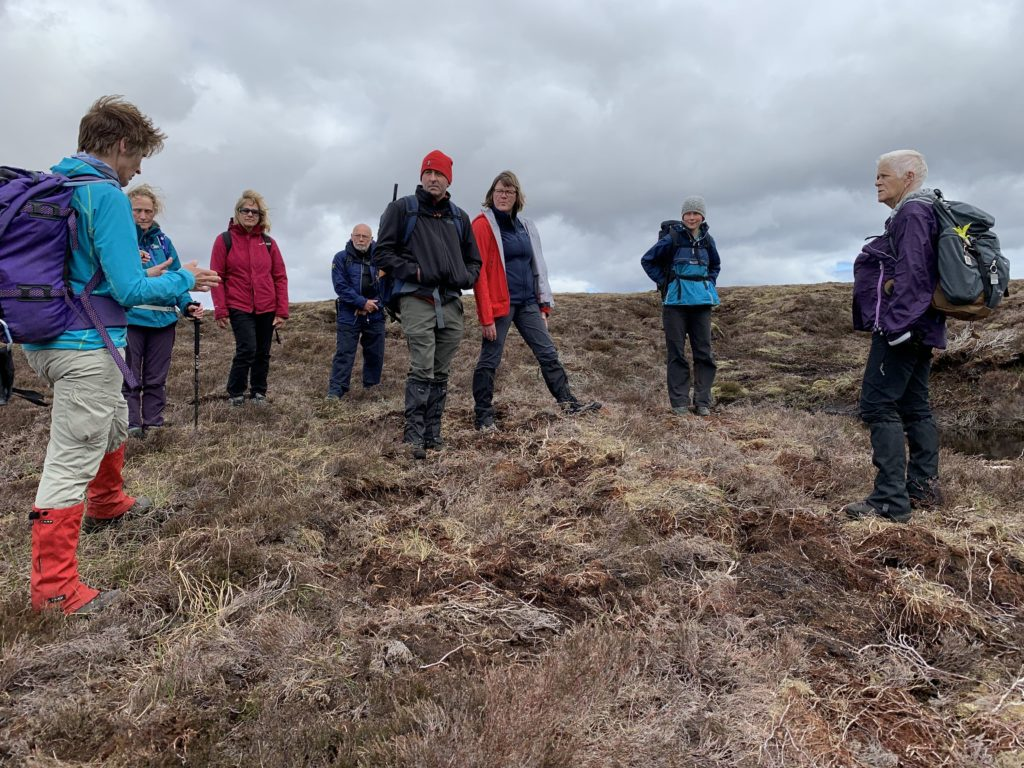 Jo Totty tells the walkers about the carbon capture taking place to protect the fragile peat bogs.
