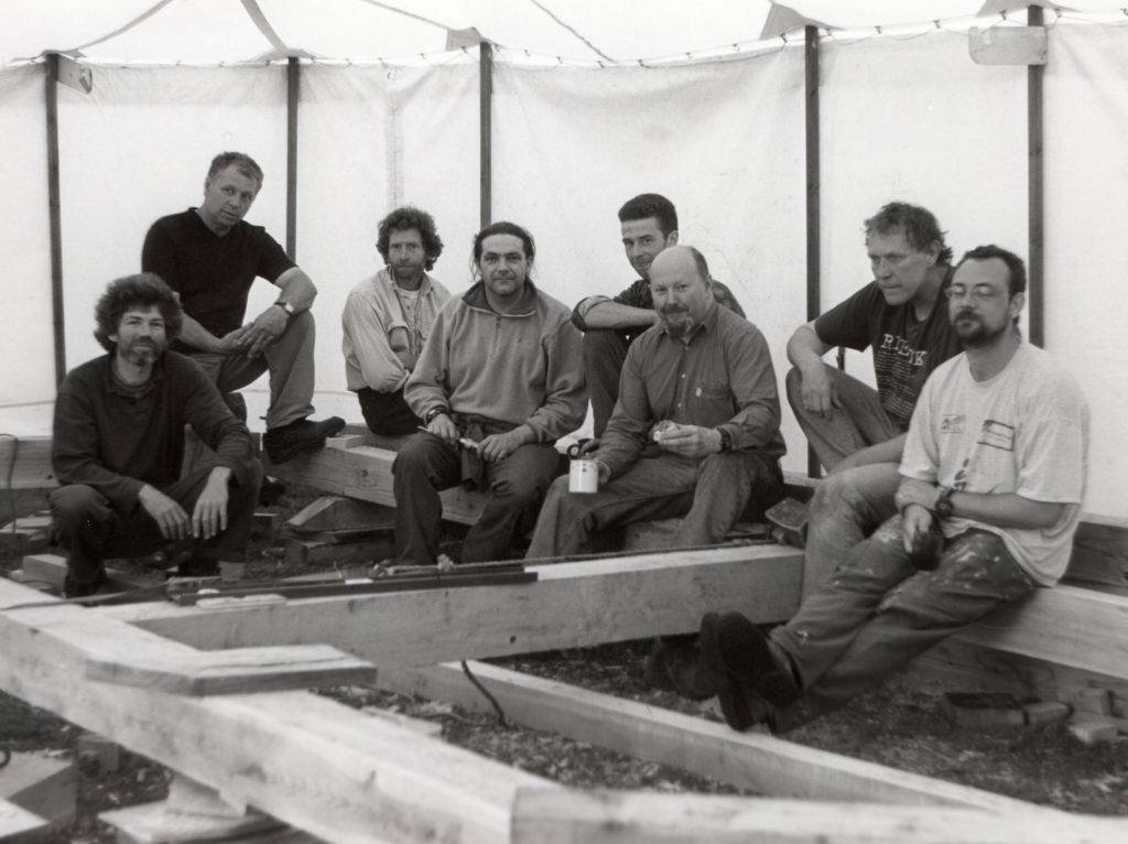 Participants enjoy a tea break during a course in traditional building. The attendees only used tools and equipment available to barn builders of several centuries ago. The wood was from Glenshant.