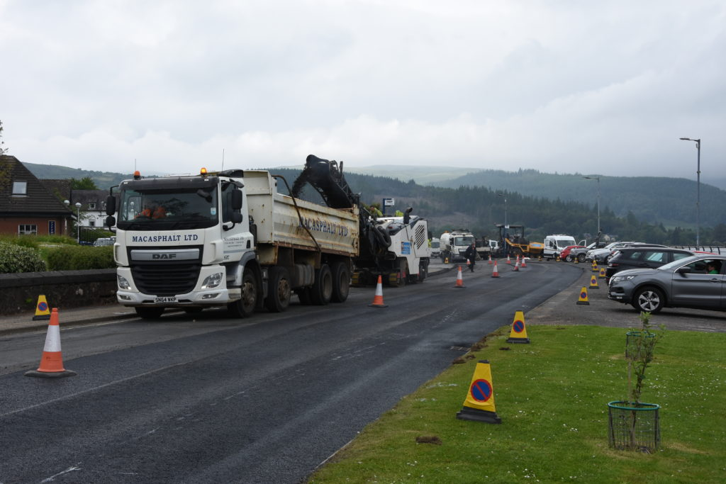 A one-way traffic system is put in place while workers resurfaced the road.