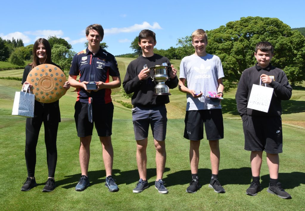 Cup winner Rory Currie is flanked by runner-up Gordon MacIntyre and 3rd placed James McCarty, junior winner Isabella Reid and Frazer Ferguson, who had the longest drive.