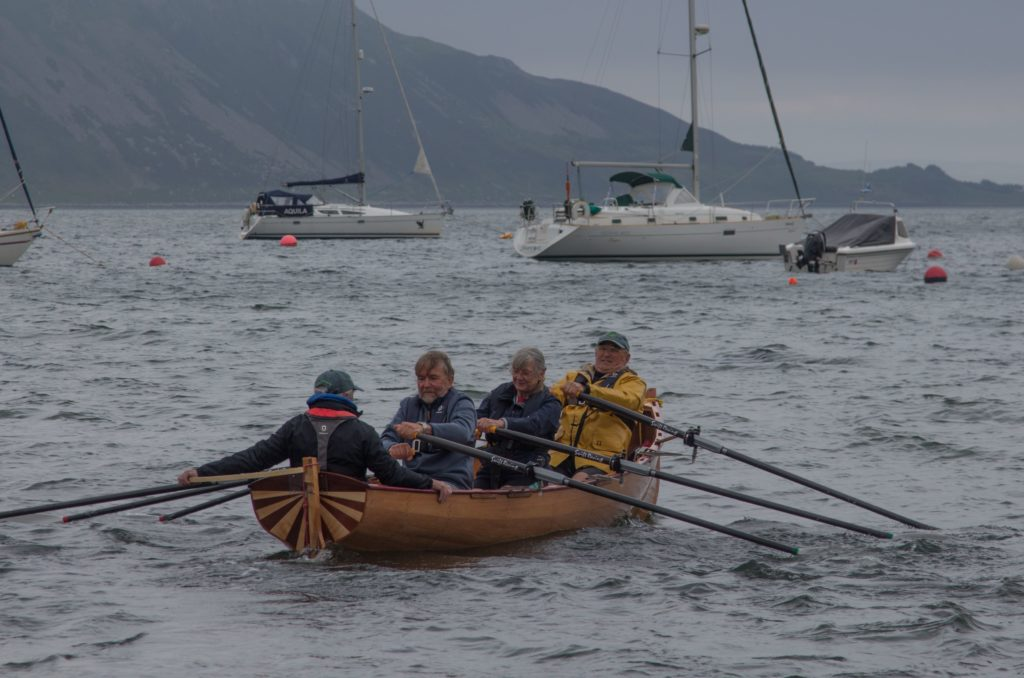 Rowers test the vessel in choppy conditions at Lamlash Bay.