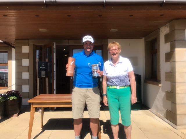 Shiskine Golf Club Championship gents final winner, Tom Mitchell with club captain Fiona Henderson.