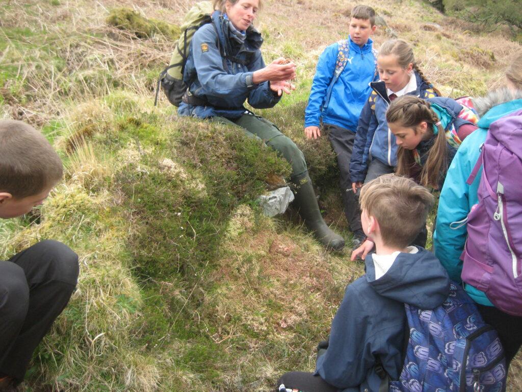 Arran ranger Corinna Goeckeritz teaches the children about sphagnum moss.