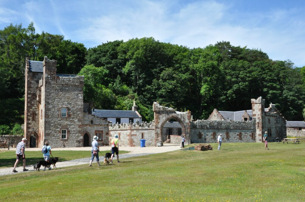 Visitors and their canine companions explore some of the interesting buildings on the estate.