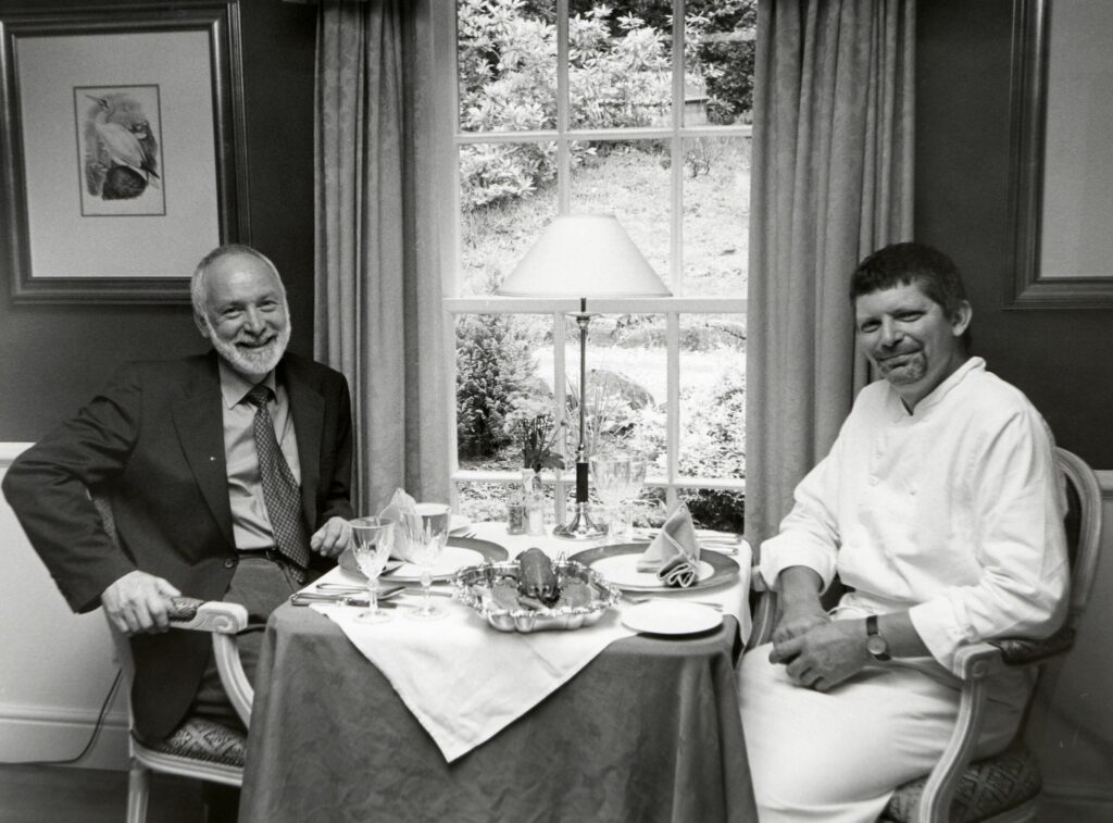 Geoffrey Botterill and Anthony Butterworth in the dining room at their Kilmichael Country House Hotel which is featured in a glossy restaurant book, Scotland on a plate.