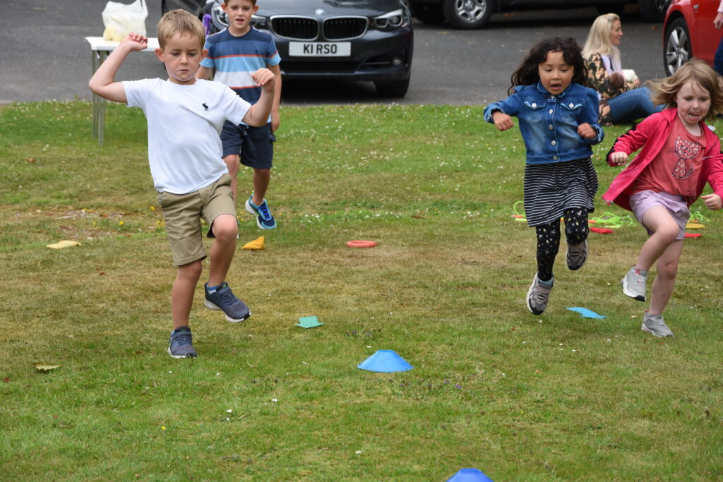 The children hop to it in the hopping race.