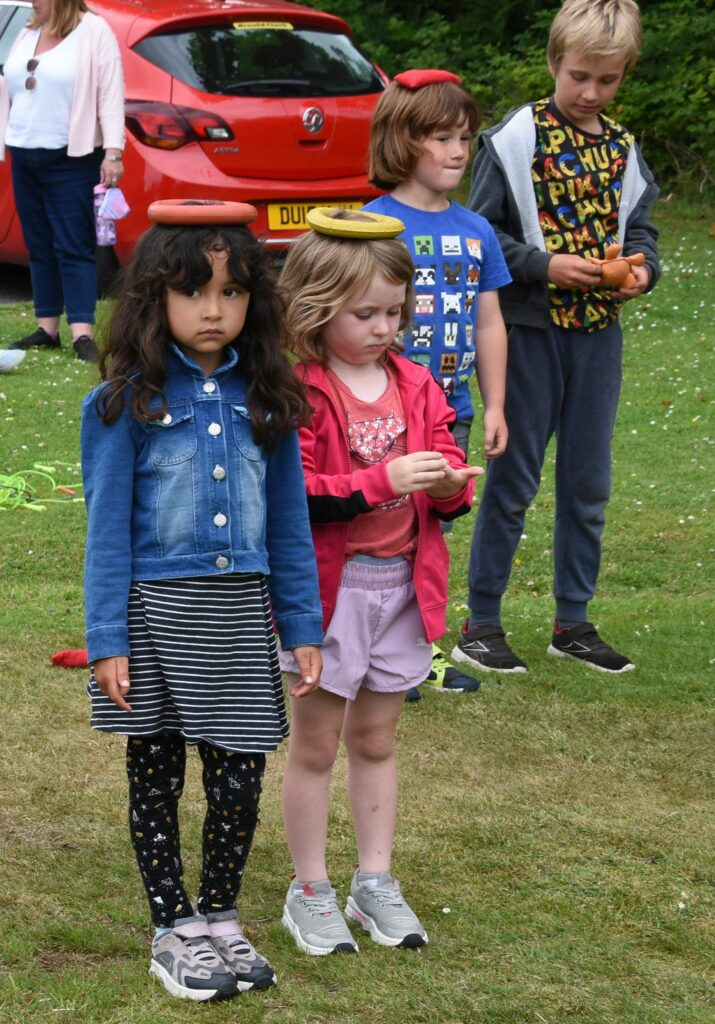 Two young girls prepare for the balancing race.