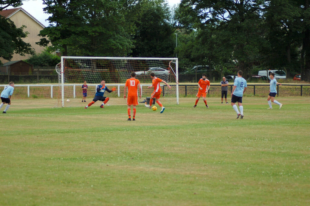 Nick Emsley blasts the ball into the opposition's goal.