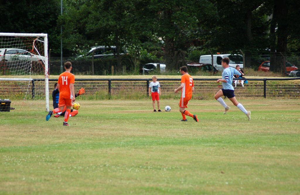 Archie McNicol outwits the Troon goalie to secure one of his three goals for Arran.